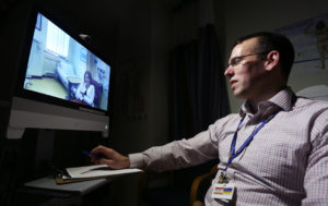 Doctor using telehealth with patient. (Photo by Paul Daly)